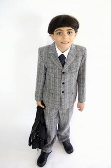 Child with a suit with a bag 3