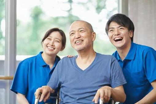 Laughing elderly and caregivers