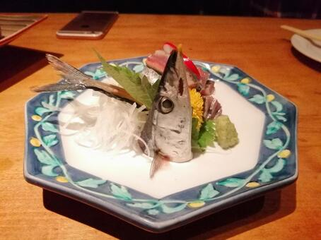 Sashimi with tail of Pacific saury