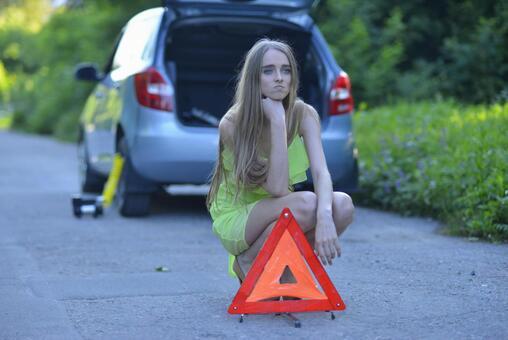 Triangular sign board and female 9