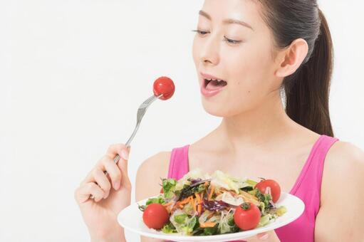 A woman eating a salad 2