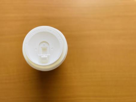 One coffee paper cup lid _ bird's-eye view