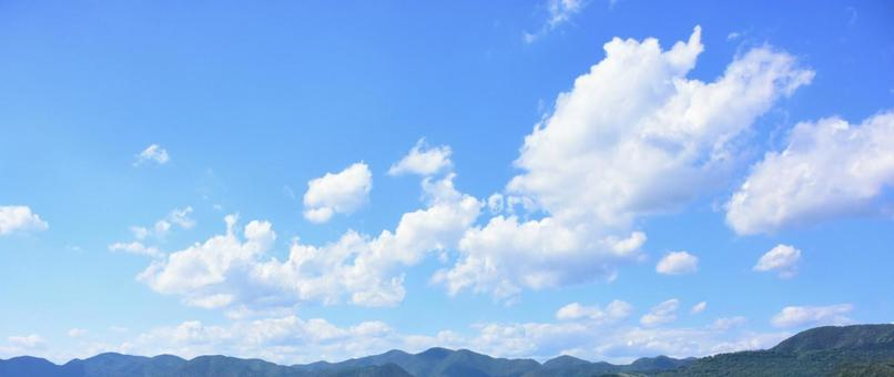 Sunny day sky White clouds and light blue sky and mountains Copy space Panorama background
