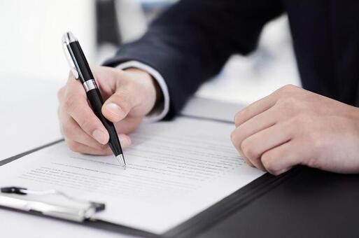 Japanese male businessman signing documents