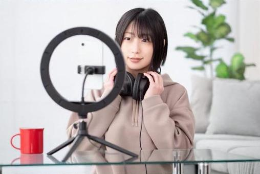 Image of a woman delivering a video