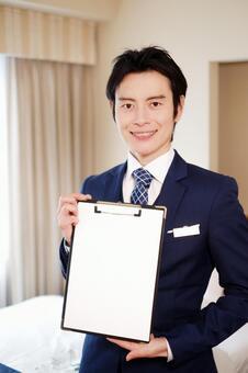 Hotel man with a binder 11