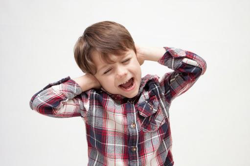 A boy blocking an ear 2