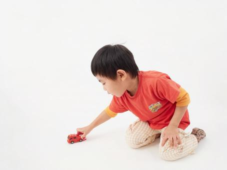 Play with a toddler / minicar on a white background