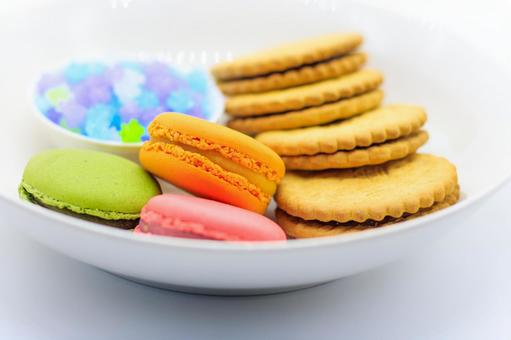 Macaroons, biscuits and konpeito on a plate