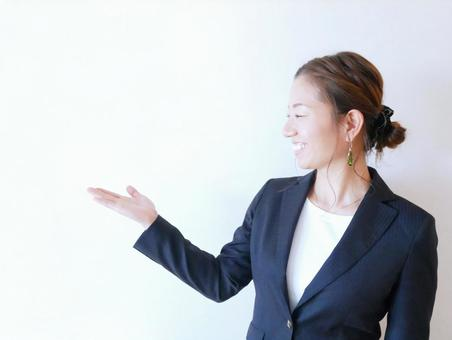 Woman wearing a suit and raising her hand