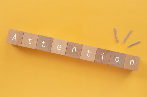 """Attention, attention   Blocks and yarns labeled """"Attention"""""""