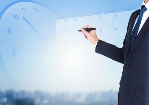 Image of a businessman with a pen and a schedule