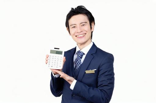 Hotel man with a calculator