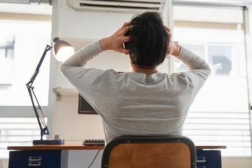 Japanese male businessman in plain clothes having troubles at home work