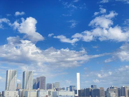 High-rise condominiums, office buildings and blue sky