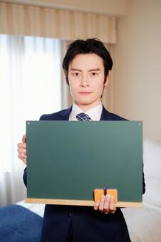 Hotel man with blackboard