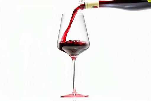 Pour red wine into a wine glass