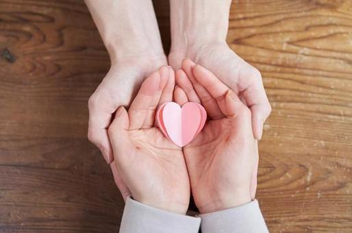 Hands of Asian men and women who nurture love