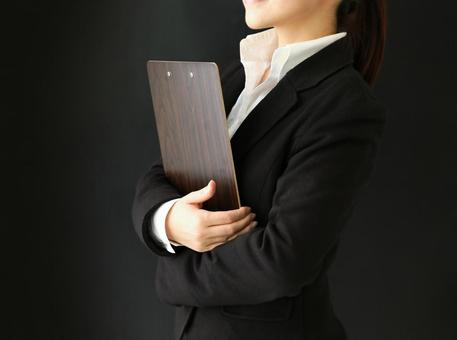 A woman with a binder