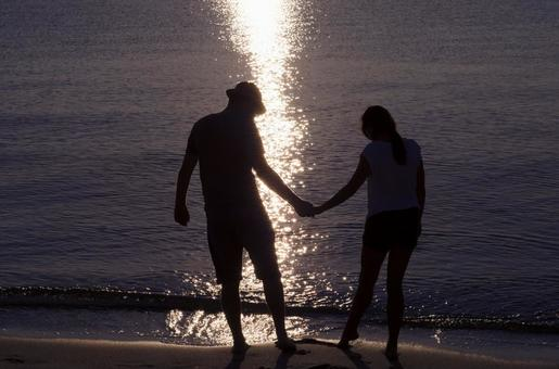 A couple's silhouette holding hands 6