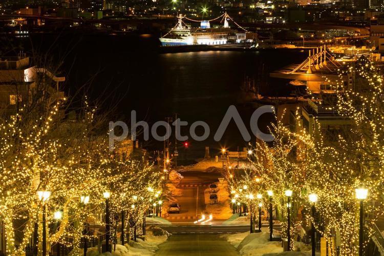 函館夜景・八幡坂と連絡船の写真