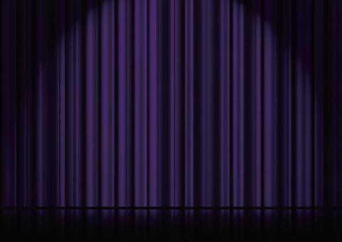Spotlighted stage and purple curtains