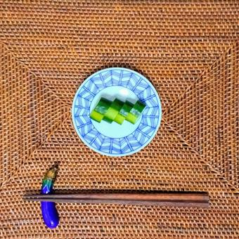 Cucumber pickles, small plates, chopstick rests, chopsticks