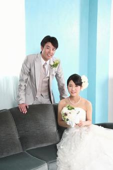 Bride and bridegroom sitting on the sofa 2