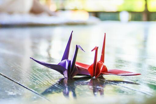 A folding crane and a couple