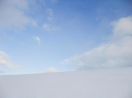 Snowfield and sky