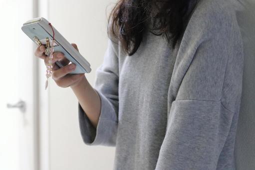 Women handling smartphone