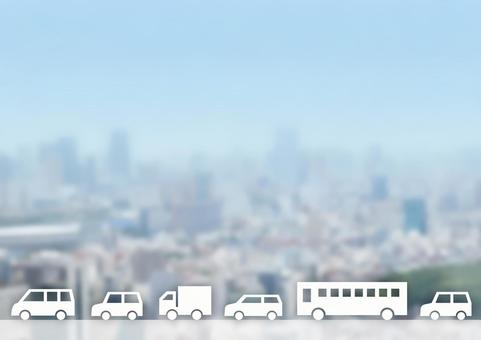 Image of cars lined up and townscape