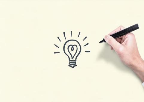Pen and light bulb