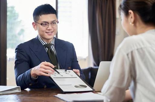 Asian male businessman explaining business plan