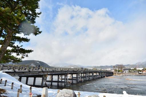Kyoto Saga Arashiyama Togetsu bridge snow scene