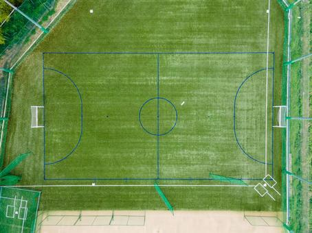 New artificial turf multipurpose futsal court (drone aerial photography)