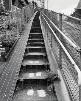 Narrow stairs on the side road Up monochrome