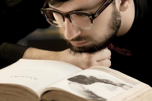 Male glasses reading a book 1