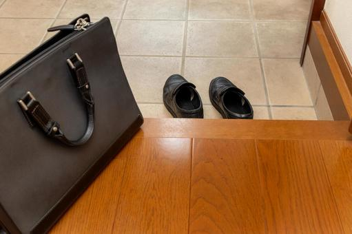 Business shoes and business bags placed at the entrance