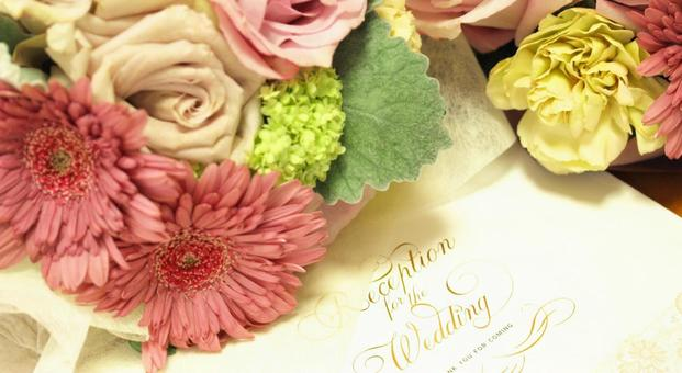 Wedding invitations and bouquets