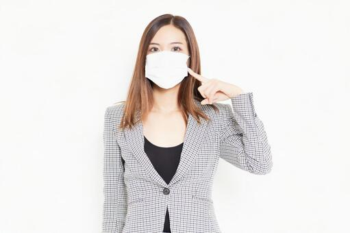 Business woman with a mask standing in front of a white background