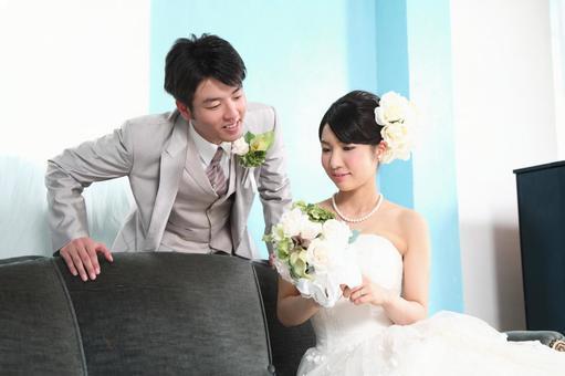 Brides and bridegroom sitting on the sofa 5