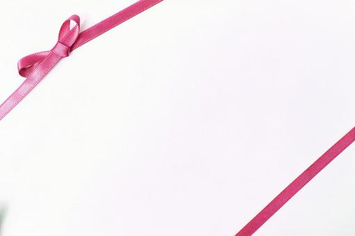 리본 질감 배경 흰색 리본 매듭의 얇은 핑크색 리본