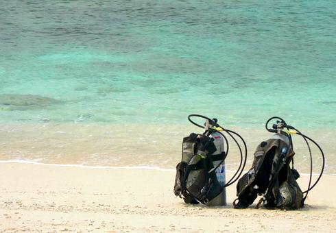 Oxygen cylinder for scuba diving placed on the beach