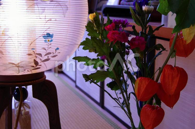 Bon  choushin (lantern) and a bunch of flowers in a house