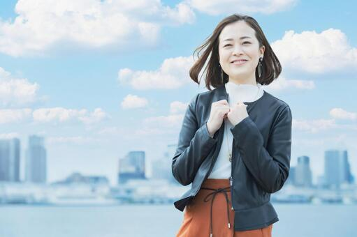Office casual style woman smiling outdoors