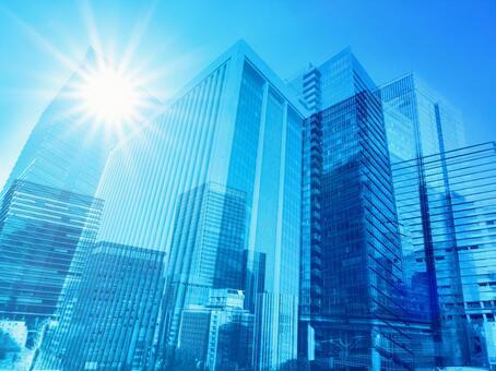 여름의 태양과 푸른 상업 지역의 추상 배경 소재