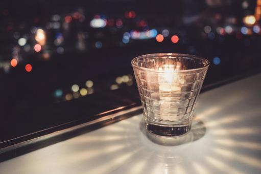 Fashionable candles and night view of the city