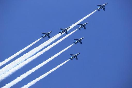 It is a flight of blue impulse that fly blue sky