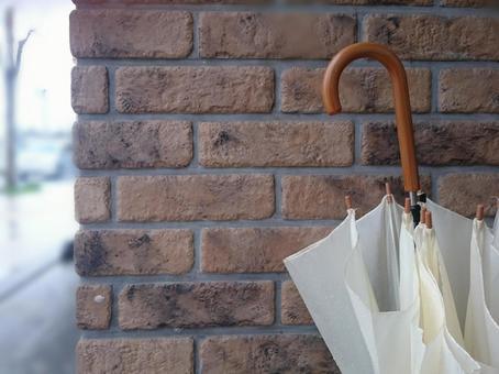 Umbrella and brick wall _ sideways